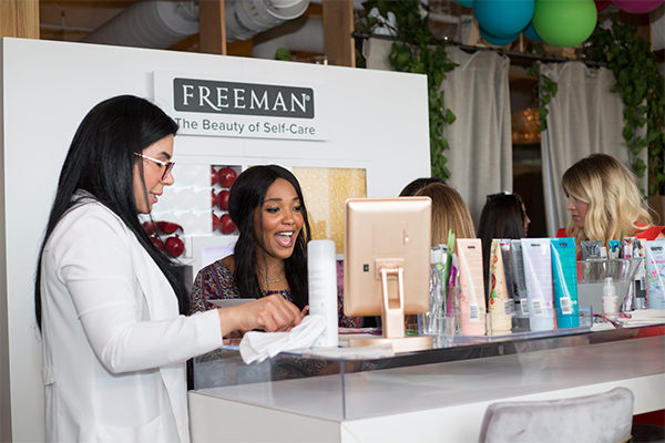 freeman hideaway beauty influencer event popup sampling experiential fgpg excited girl ipad
