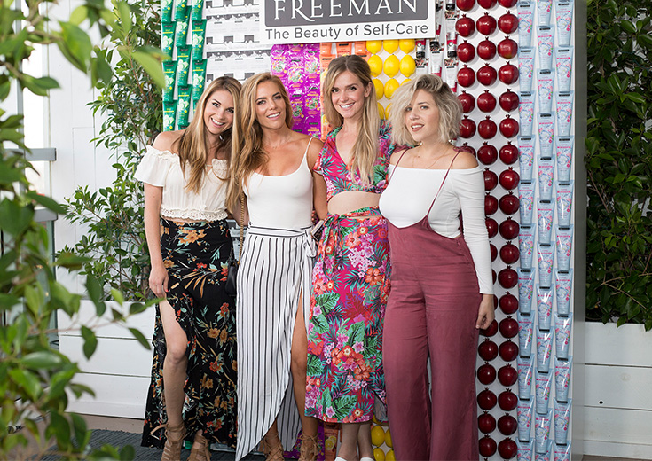 influcencers pose custom photo wall freeman beauty popup event