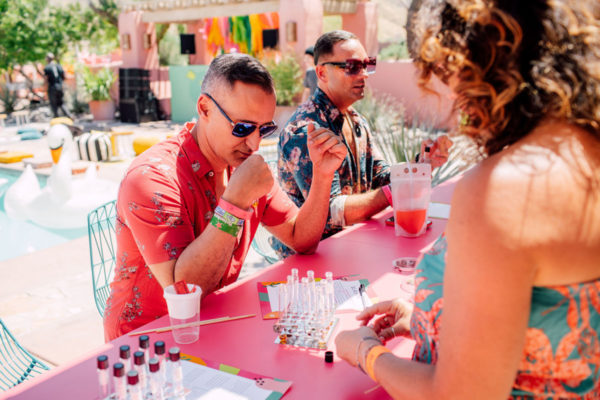 men sitting at a fragrance bar at an instagram coachella pop up experience