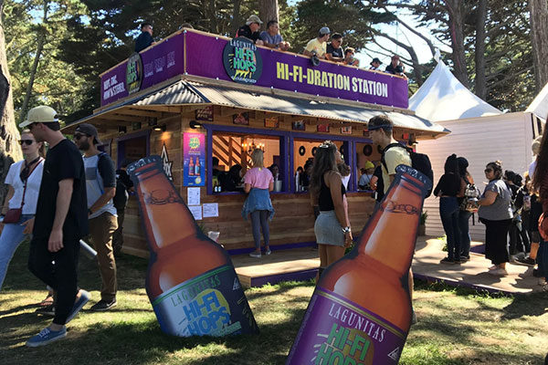 lagunitas hi-fi-dration pop-up at outside lands with beer bottle cardboard cutouts