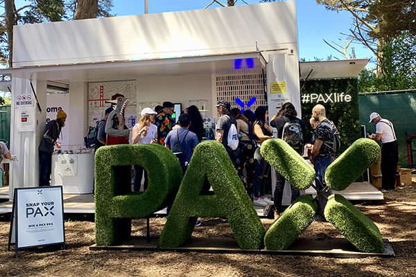 pax pop-up experience at outside lands with pax sign made of grass