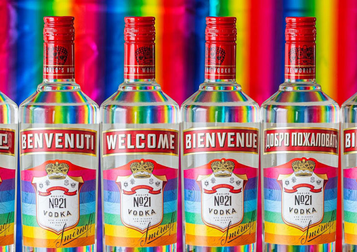 smirnoff vodka bottles in different languages on a rainbow background