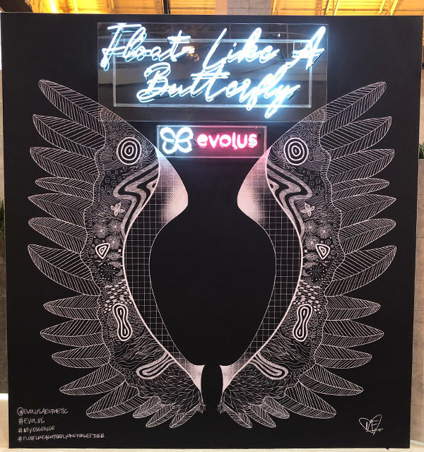 evolus brand activation trade show booth butterfly wings neon lights fgpg experiential