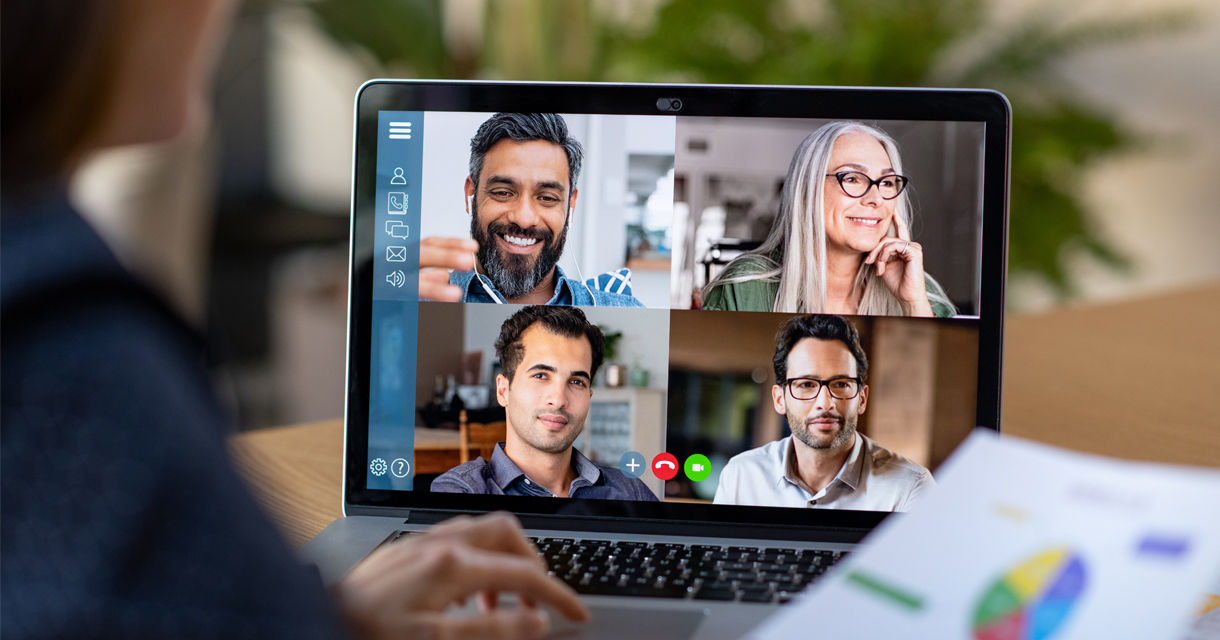 laptop showing video conference call with four team members