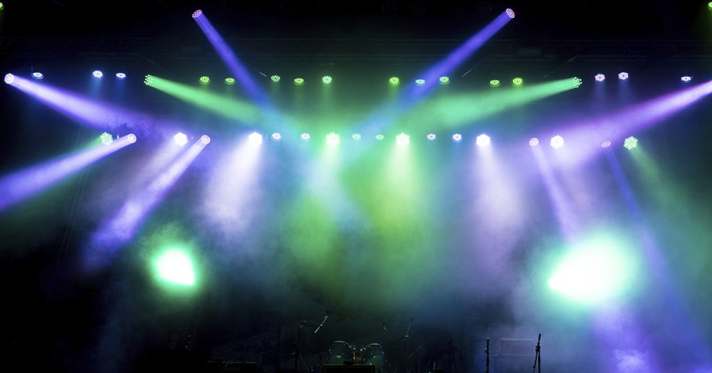 Purple and green stage lights with haze