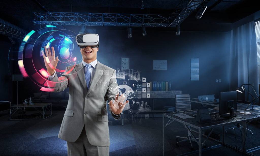 Businessman in VR headset and touch screen. Mixed media